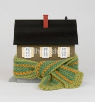 80605869-miniature-house-wrapped-in-scarf-thinkstock